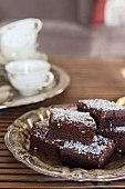 Swedish chocolate and coconut brownies on silver plate