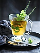 Peppermint tea with sprigs of fresh peppermint