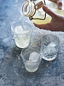 Lemonade being poured into glasses