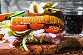 Ham, gherkin and tomato sandwich