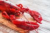 Cooked lobster on a chopping board (detail)