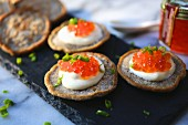 Blinis with sour cream and salmon caviar