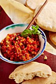 Pepper and chilli chutney with pita bread