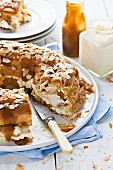 Paris brest with banana, cream and caramel sauce (sliced)