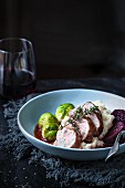 Pork fillet with a red wine vinegar sauce served with Brussels sprouts and mashed potatoes