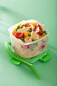 Lunch box with pasta salad and vegetables