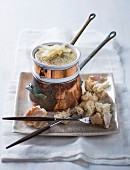 Four cheese fondue with grated Parmesan and croutons