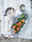 Salmon fondue with a coconut milk and onion dip (Thailand)