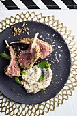 Lamb chops with a lemon and rosemary crust, bean purée and mint