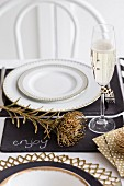 Festive place setting with champagne glass