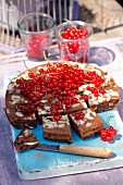 Chocolate cake with almonds and redcurrants
