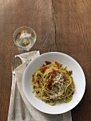Pasta with pistachio pesto and crispy bacon