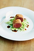 Saddle of venison on a savoy cabbage medley