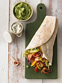 Chicken wrap with vegetables, guacamole and crème fraîche