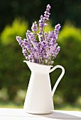 A jug of lavender on a garden table