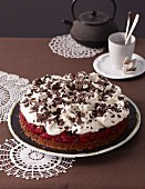 Creamy cherry cake with grated chocolate