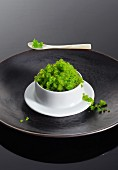 A bowl of green tobiko caviar from flying fish