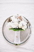 A bride's bouquet on a silver plate