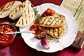 Grilled pork loin with pepper relish and pita bread