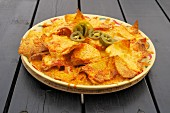 Nachos top with grated cheese
