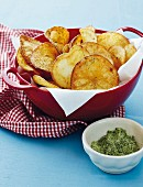 Homemade potato crisps with rosemary salt