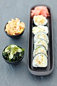 Sushi with squid in tempura, wakame and kimchi salads
