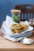Chickpea fritters with lemon sour cream and lamb's lettuce