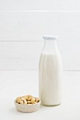 Cashew nut milk in a glass bottle