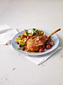 Pork chop with tomatoes, potatoes and garlic