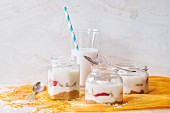 Rice desserts in glass jars, rice milk and rice grains
