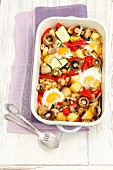Oven-baked, eggs with potatoes, courgettes, mushrooms and peppers