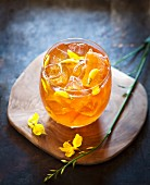 Honeybush iced tea with lemon and honeybush flowers