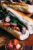 Saddle of venison with rhubarb chutney on a baguette