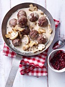 Köttbullar (Swedish meatballs) with a mushroom sauce and lingonberries
