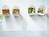 Four filling low carb salads in takeaway boxes