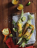 Grilled corn cobs with coriander, Parmesan, chilli and garlic butter
