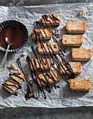 Vegan macadamia nut confectionery with dark chocolate drizzle