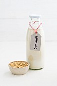 Oat milk in a glass bottle with a label