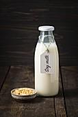 Soya milk in a glass bottle with a label