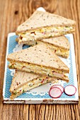 Sandwiches with egg salad and radishes