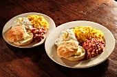 Scrambled eggs with corned beef hash, grits and American biscuits