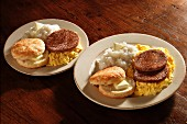 Scrambled eggs with sausages, grits and American biscuits