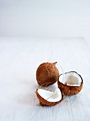 Coconuts, whole and cracked open