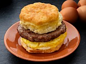 An American biscuit with sausage and scrambled egg (USA)