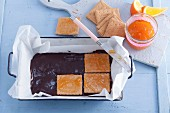 Chocolate terrine with butter biscuits being made