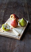 Assorted pears on a wooden chopping board