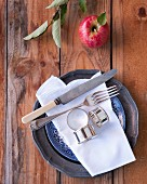 Old cutlery and linen napkin on plate