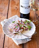 Angelfish ceviche with red onions