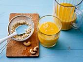 Gluten-free mango drink with cashew nuts