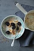 Millet porridge with blackberries and hazelnuts